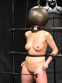 Mz Berlin vs Odile : Odile has been begging for attention from Mz for months. Cunt should be more careful of what she wishes for. Displayed spread eagle in unforgiving restraints she is unable to appreciate her accessibility due to the punishing metal globe encasing her head. Failure seems to be the only option available to cunt as she struggles to deal with the cane, cattle prod and cruel nipple stretching clamps. Her only comfort is the echo of her own screams inside her metal prison. Unable to please Mz she is taunted with tease, denial and harsh verbal humiliation and scolding. So disappointing...Clearly this bitch needs to be schooled. The punishment begins with the position in our second scene. Locked in a kneeling strappado, cunt endures a wooden breast vice, neck and wrist stocks and metal shackles. Feet, ass and cunt are exposed and worked over with precision by Mz, overwhelming cunt. A painful paddling and tight labial clamps push our pretty piece of meat to the edge and painful orgasm denial keeps her right on it.Finally cunt is bound in a face up modified frog position, held in place with tight leather. A head harness finally allows her to see the torments in store. Wax and nipple clamps get this pain party started. Her ripe pussy exposed for smacking and excruciating flicks before being stuffed full of a hard, steady fist. Cunt is violated and exhausted after the onslaught of orgasms that ensue. Guess shes only good for one thing- being a whore.