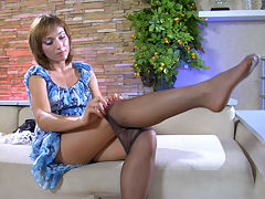 AmeliaC in naughty pantyhose video : When a girl buys a fresh pack of hose, she cannot resist trying them on, and neither can Amelia C. She puts on her faintly reinforced dark tights to match her sexy French maid outfit and black high heels, so now you can admire the sleek look of her legs with barely visible wet gloss. The babe cant help touching and fondling her legs herself, so imagine how soft and smooth they will feel under your palm!