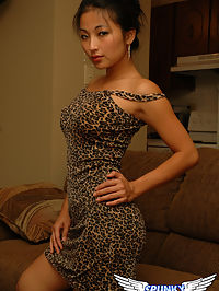 Busty asian teen Aria Lee strips out of her sexy little leopard print dress