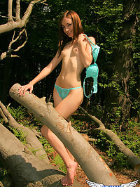 Skinny teen shows off her perfect perky tits as she strips out in the woods