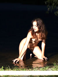 Presenting Jame : Cute young girl takes her white clothes off and poses nude on the night lake.