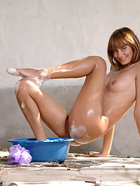 Summer shower : Playful sexual red girl with hairy pussy is washing in the dark blue basin outdoor.