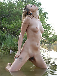 Brilliance : Cute blond poses nude on the green beach.