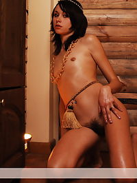 Gold : Magic angel Alla with hairy pussy poses naked indoor.