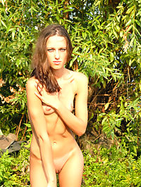 Branches : Beautiful brunette Nadya goes to bathe naked luring us into the water.
