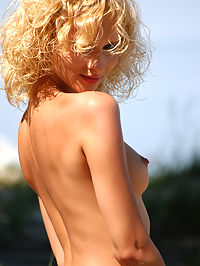 Introducing Lena : Young blond takes her clothes off and shows her fantastic body on a beach.