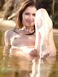 Drops : Young beauty Assole captivates you with her fine body on the water.