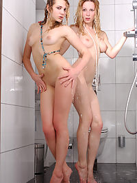Team Shower : Two lusty babe, Niki Mey and Yara, enjoys a naughty, erotic bath together in the shower.