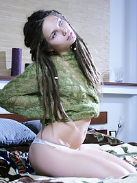 Untamed : Long, dreadlocked hair, sultry blue eyes and sexy pouty lips, beautiful puffy breasts, firm, tight ass and slim, slender body to-die-for.
