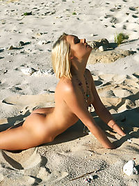 Kactos : Absolutely stunning beach babe Deni shows off her smooth, gorgeous body and perky, tight assets as she frolic on the sand and water.