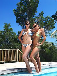 Syrines : Two stunning luscious babes, drenched and wet but still smolderingly sexy, strips their ultra-sexy bikini and raising the temperature further with their artistically provocative poses.