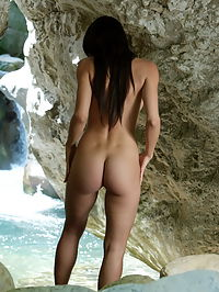 AnnaMaria : Sexy babe AnnaMaria with long black hair spread her legs and show her tits on the white rocks