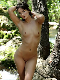 Marion : Marion loves open air nudity and she is posing nude by the river streams for us
