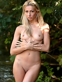 Stella : Shy blonde babe gets naked by the river in the forest and show her tiny tits and pussy