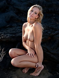 Leslie : Blonde babe with small tits Leslie gets naked by the black rocks