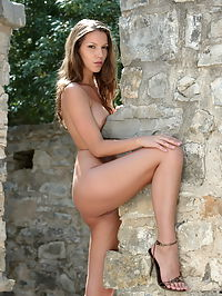 Angela : Brunette babe with big tits Angela gets naked in abandoned monestary