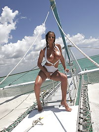 Roberta Missoni : Babe with big boobs Roberta Missoni in white bikinis gets naked on the boat and show her huge tits and pussy