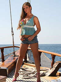 Rita Faltoyano : Busty babe Rita Faltoyano posing nude for us on the boat before she gets fucked by two guys