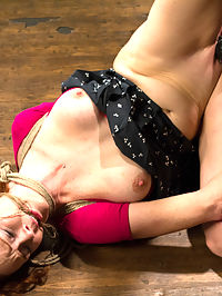 Audrey Hollander - Bitch Still Has It : Welcome tough and beautiful Audrey Hollander to the stage. Tenacious, flirty ginger gets it hard today on HogTied. First up she is bound in the same tie three ways. First standing, the hardest. We watch the sweat pour off of her body as she tries to maintain the incredibly challenging position. After amazing endurance, our ginger bitch is let down to the floor and given a predicament. For as long as she takes the vibrator is as long as she has to endure an incredibly brutal suspension.Second, Audrey is bound in sensory deprivation with a gag, panty hose, and a cruel tape gag over the hose and gag. That however is the least of her worries. She is far more concerned with the brutality of the bondage. Since she cant see, her precarious balance on the box elevates hear fear. Enter the flogger and the vibrator. Intense orgasms our worked from this gingers cunt, every one intensifying her anxiety.Finally, ginger cunt is bound in a straddle spread suspension. Claire goes after her with the tazapper relentlessly until Audrey pleads. This time there is no stopping the vibrator or the insane amount of orgasms this cum hungry whore has. Job well done Audrey. Well see you again soon bitch.