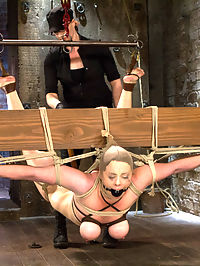 Bimbo With Big Tits Gets Wrecked! : What do you do with an ungrateful and sassy cunt that just wants to get off? You tie the bitch up and give it to her hard. In her first predicament, cunt is bound in a breast hair elbow crotch rope bondage predicament. First in heels she prances around with all too easy of an effort. The shoes come off, making her tip toe uncomfortably. Enjoying her struggle, the ante is upped with giving the cunt a precarious wood pyramid to balance on as her feet, calves, and ass are caned. Add a vibrator, remove the pyramid, and watch the desperate struggle and pleasure unfold.Second, our warmed up cunt is bound in an uncomfortable squat. Cruel labial clamps are attached and stretched very tight to her toes. A flip cat lashes her juicy ass and tits. The cunt tries desperately to avoid the pain... and we enjoy her desperation. All of her whore work pays off and she is rewarded with innumerable orgasms. She loses track of how many, so much so that she is barely able to communicate - stunned with pleasure.Finally, she is on her knees - in her rightful whore place. Unable to see the activities Claire has planned for her, she is terrorized with the tazapper. Her nice juicy ass is tanned to a bright red, prepping her for a strenuous bow style back arch suspension. Confronted again to succumb to the pleasure, she is a writhing drooling hot mess - completely controlled by the hands in her holes and the immense pleasure of the vibrator.