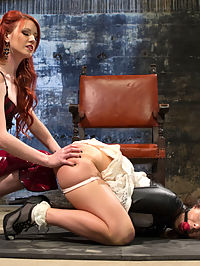 Elle Alexandra, gorgeous redhead dominatrix punishes Mia Gold! : Welcome the all natural redheaded lesbian dominatrix, Elle Alexandra to Whipped Ass! Elle is an undeniably sexy domme with a thirst for punishing girls! Mia Gold is a cute submissive with a round ass perfect for spanking! These two met a year ago to the day and havent seen each other since. Elle teaches Mia what the last year has done for her with sexy verbal, hot spanking, challenging bondage, dildo gag, clamps, flogging, finger banging and strap-on ass fucking!