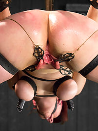 Nerine takes it all! Intense immobilizing positions : Nerine is clearly not new to kinky sex so here on Device Bondage we must give this pain-slut a proper challenge. Position 1 has her on her knees with neck restraints. Her ample breasts are highlighted with bondage and nipple suction. It takes a cock in her throat and a single-tail on her backside to make this bitch cum! In Position 2 she is suspended high up in metal and leather straps with her ass and pussy conveniently exposed with spread legs. She gets vicious clover clamps on her pussy lips but this does not prevent her from begging to cum with the dick-on-a-stick pounding her. Position 3 is a simple back arch with creative nipple clamps stretching her breasts taut. She has a great caning session to top it all off! A very intense scene with great chemistry between Dom and Sub.