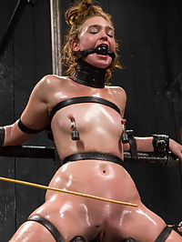 Jodi Taylor LIVE : In the first position, Jodi is shaped into an intense kneeling strappado with metal. Her ass is high in the air and perfect height for intense corporal, as are her feet. Her ass hole too is begging for painful attention. Claire and Mz make sure Jodi suffers, repeatedly denying her the reward of orgasm. Its far too early for pleasure.Second, Jodi gets a very intense breath play predicament. She is folded in leather on a nicely dirty mattress and choked upward with leather straps. Mz adds to the intensity by smothering Jodi with her large breasts, then tilting the head upward for a more extreme choke. Her labia are spread open with clamps and cunt hole rammed full of cock. The orgasms that erupt from her body are intense and incredible.Finally, Jodi is installed upright on two padded boards and leather. A fucking machine is inserted into her cunt and relentlessly bangs into her hole... coaxing every bit of cum this bitch has. She gets oiled up, watered, caned, and intense nipple clamps as Claire and Mz work her over into a well used mess... all LIVE for you.