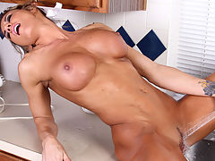 Naughty milf slips off her sexy maid costume to reveal her extremely toned body and full round tits then uses the kitchen sink to make her pussy cum