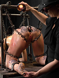 Siouxsie Q vs Claire Adams : Raven haired and American Sioux Indian Siouxie Q signs up to be mercilessly tormented by Claire Adams. Be careful what you wish for, or you just may get it.SCENE 1Siouxsie is bound kneeling in a latex box tie arm binder, latex posture collar, latex head harness, leather straps, thigh high stockings, and high heels. She mentions breast bondage scares her, so we fully exploit her fears and aggressively try to push her off balance and out of her comfort zone. Breast and genital caning are quickly followed by clothespins all over her torso. A blindfold is added and the clothespins are single tailed off until she cant take it any more. To reward her pain journey, the vibrator and punishing hand fucking enter the picture. We find out that she is a squirter... and what kind of cum slut she is going to be.SCENE 2She is in a chain dog house. Her neck is pulled in four directions by chain in a metal collar. Her ass is held up in doggy by chains around her legs and her wrists and ankles are screwed into the platform, entirely preventing her from escaping. A speculum is inserted into her asshole, going deep into her. A dick on a stick enters the picture and fucks her through the anal speculum. Claire goes after her feet with the cane. Her body is greased down like a pig and then layered with sheets of wax. The dick re-enters, fucking her pussy now. The bitch cums and cums. Unable to free herself, she has no choice but to submit.SCENE 3Finally, she is bound sitting on a vintage metal tractor seat. Her ankles are bound in cruel metal shackles and her wrists wrapped around her legs, secured in handcuffs, and attached to her neck. Tape is added to her hands and they ares shaped into balled fists, so there is no way she can help or alleviate her suffering. The only way Claire is going to hurt Siouxsie is if she begs for it. Her feet and ass are caned. The thighs earn nice red stripes against her creamy skin. She squirms and tries desperately to get away, which only makes Claire want to cane her harder and hurt her more. The cunt is on display for us to see, and ripe for the pickings. Since our slut cums so easily, its time to see just how many we can get out of her...