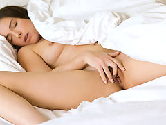 This sexy nymphet likes to start her mornings with a self induced orgasm