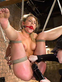 Mega Hottie Bailey Blue : Welcome Bailey to round one on HogTied. This hot princess gets introduced to the pain and pleasure of intense rope bondage, relentless orgasms, and pain games. In scene one, she is bound in an asymmetrical bondage arrangement and tormented with the tazapper, tickle torment, and flogging. She is then transitioned onto her side, so we can get better access to her cunt to take advantage of this wanton slut. Second, she is bound in a face up pile driver suspension. Her feet are mercilessly caned, now that we know how sensitive they are. Clamps are added and tightly grab the flesh of her labia, and clover clamps to her nipples. When in the air, her asshole is repeatedly violated by Claires fingers and a thick black dick. Finally, she is bound in what looks like a comfortable position, but clearly not for long. Suction tubes suck in her nipples and clit, making them swell to a nice cherry red. Her tongue is clamped too and then, she is made to suck cock like a good whore. Since her cunt is busy being partially sucked in by the clitlabia tube, our self proclaimed ass slut is pounded in the ass. Now, comes the hard part. Bitch is hoisted upside down by her knees. Dangling in the air, she is fisted into multiple explosive orgasms. She writhes in pleasure and pain, not sure what to do other than cum and cum and cum. Well see you again, bitch.