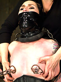 Mizz Amanda Marie - Rough Rider : Like girls who love pain? Let me introduce you to Amanda. Girls who can either take a lot of pain or extreme bondage are earning a title in a new category - rough rider. Our little cunt likes large things stuffed in her mouth an severe gags, so in scene one, she gets my favorite latex beanie hood, with a black gag, and latex tape over the gag. With only her nose to breathe from, she gets antagonized with breath control. Quickly she understands that Claire is not a very nice lady.Second, Amanda gets introduced to the cattle prod, tazapper, and zipper with the most painful clips we have. Then she is hoisted in an extreme chain only suspension, ebi style. Blindfolded and swinging in the air with no point of reference, she gets lost in space as the game of pain and pleasure overwhelms her.Finally, she says she loves pain, especially to her thighs. Claire loves tormenting bitches legs, and goes after her with gusto laying down thick colored stripes of compressed flesh. Her ass is lifted into the air for a better presentation and easier access to her cunt. Strapped down, there is no way she can escape from the pain or pleasure.Her caning position gets transitioned. Claire installs the inflatable latex balloon hood on her where the breathing tubes run to the top of the head. She cannot see out at all. Amanda is suspended upside down by her ankles and single tailed with the vibrator on her and nipple clamps. The combination of pleasure and slicing pain sends her over the edge into orgasm oblivion.