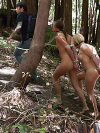 Bonding in Nature Step Mom and Daughter BDSM Camping Adventure : Secrets are revealed, compromises made and what ensues is the most epic forest fuck fest youve ever seen. Talk about bonding with Nature! Tommy Pistol brought some rope to this party and its not for rock climbing! First he ties Krissy Lynn and Cassandra Nix up double doggie style by the campfire and fucks them deep and hard under the moonlight. In the morning he takes the two naked and bound girls on a hike to the summit where they endure punishment beneath a blazing sun. Then Tommy takes them deep in the forest and fucks their asses while they are helplessly tied to trees. If you are looking for a long, hot, wet and wild summer camping adventure now is your chance!