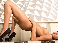 Gorgeous babe in high heels peels off her panties to masturbate