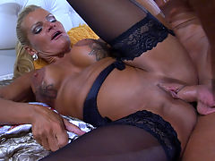 Hannah and BenjaminM kinky mature movie : Voluptuous blonde milf Hannah and her younger studly lover Benjamin M. are in the bedroom now, and he finally can get his hands on these massive mature boobs hes been drooling over for days. He also lets her devour his fat beef to her hearts content giving him one hell of her branded mature blowjob. Then she hops on top of him ready to ride his young rock-hard dick and take it into her itchy old muff in every other possible way.