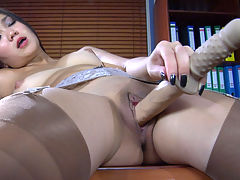 MimaA showing her stockings : When Mima A. feels the itch in her pussy in the middle of the working day, she produces her handy fuck toy, parts her nylon clad legs and starts shamelessly pleasuring herself. You will also notice that this naughty office slut isnt wearing panties under her dress, so after flashing her bare ass cheeks, she climbs her working desk giving you a nice close-up view of her nylon dildo toying.