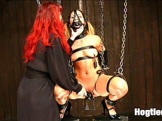Mz Berlin vs Andre Shatki : Andre Shatki is new to Device and at the hands of Mz Berlin, is sure to have a rough time. Throughout the whole day she is tormented in vulnerable metal and leather bondage. She submits to a creamy fisting, zipper, weights, fatigue position, challenging caning, and lots of corporal discomfort!
