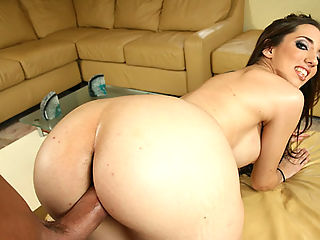 Curvy brunette Kelly bounces her huge ass on a big cock
