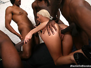 Slim blonde slut gets gangbanged by black guys while her boyfriend worries from home