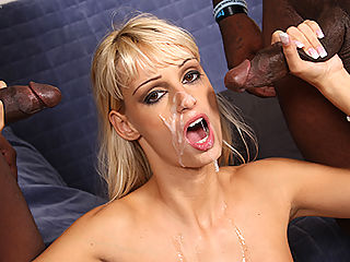 Gorgeous blonde gets worked over by a couple of big black dicks
