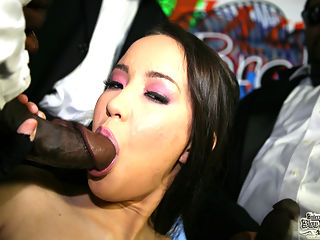 Sexy asian is at the mercy of a gang of angry black men