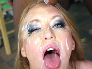Horny redhead gets gangbanged by tons of hung black cocks