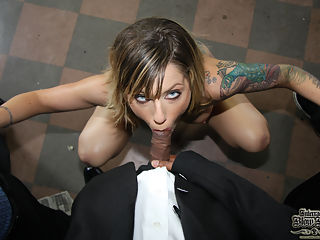 Tricia Oaks sucks on 8 black cocks until they explode in her face