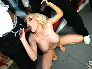 Big tittied blond gets gangbanged by an angry group of black guys