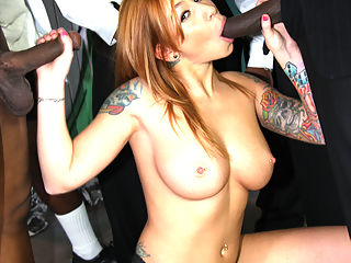 Tattooed redhead milks black cocks with her mouth and hands