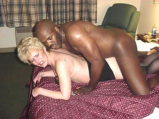 Bald black guy pounds blonde babe in boots.