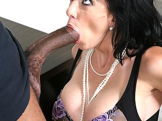 Stacked brunette takes some huge black dick