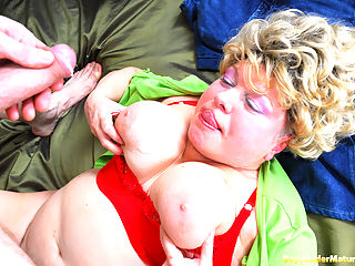 Linda is a kind of permanently horny oldie that doesnt take no for an answer. She is killing her time with a magazine waiting for her young and pretty hung lodger. When this chubby granny takes out her massive jugs, the boy looks astonished and uneasy. But then the nasty old bitch shows what shes really after. Its his sizable manhood that she wants into her mouth and worn out twat, and of course she needs some milky icing for her big hooters.