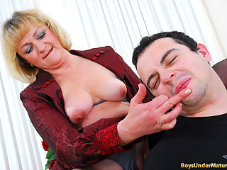 A coffee break may go somewhat wrong when your older lady-boss gets too hot. First Anna wants to see her younger employee at her feet, then she makes Patrick taste her ripe boobs and lick her fingers, so she can rub her itchy beaver. No matter how stunned or unwilling he is, the guy has to follow the bossy moms instructions. Soon she claims his manhood for a deep throat job before testing his muff-diving and pussy pounding skills.