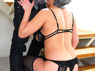 Greying old hottie Jennifer was in ambush under the stairs waiting for her young neighbor. When Felix showed up, she surprised him wearing just her black peek-a-boo teddy and matching stockings. At first the boy seemed too shy to join in on the fun, but he slowly warmed up to this game. He kissed her hard nipples and greedy mouth before going down there for some rug munching. After the milf gave him head he came to the point of no return.